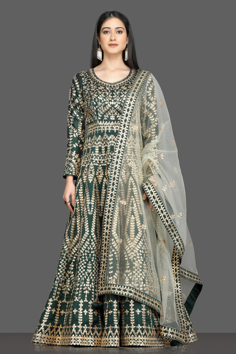 Shop beautiful dark green gota work Anarkali online in USA with net dupatta. Dazzle on weddings and special occasions with exquisite Indian designer dresses, sharara suits, Anarkali suits, bridal lehegas from Pure Elegance Indian fashion store in USA.-full view