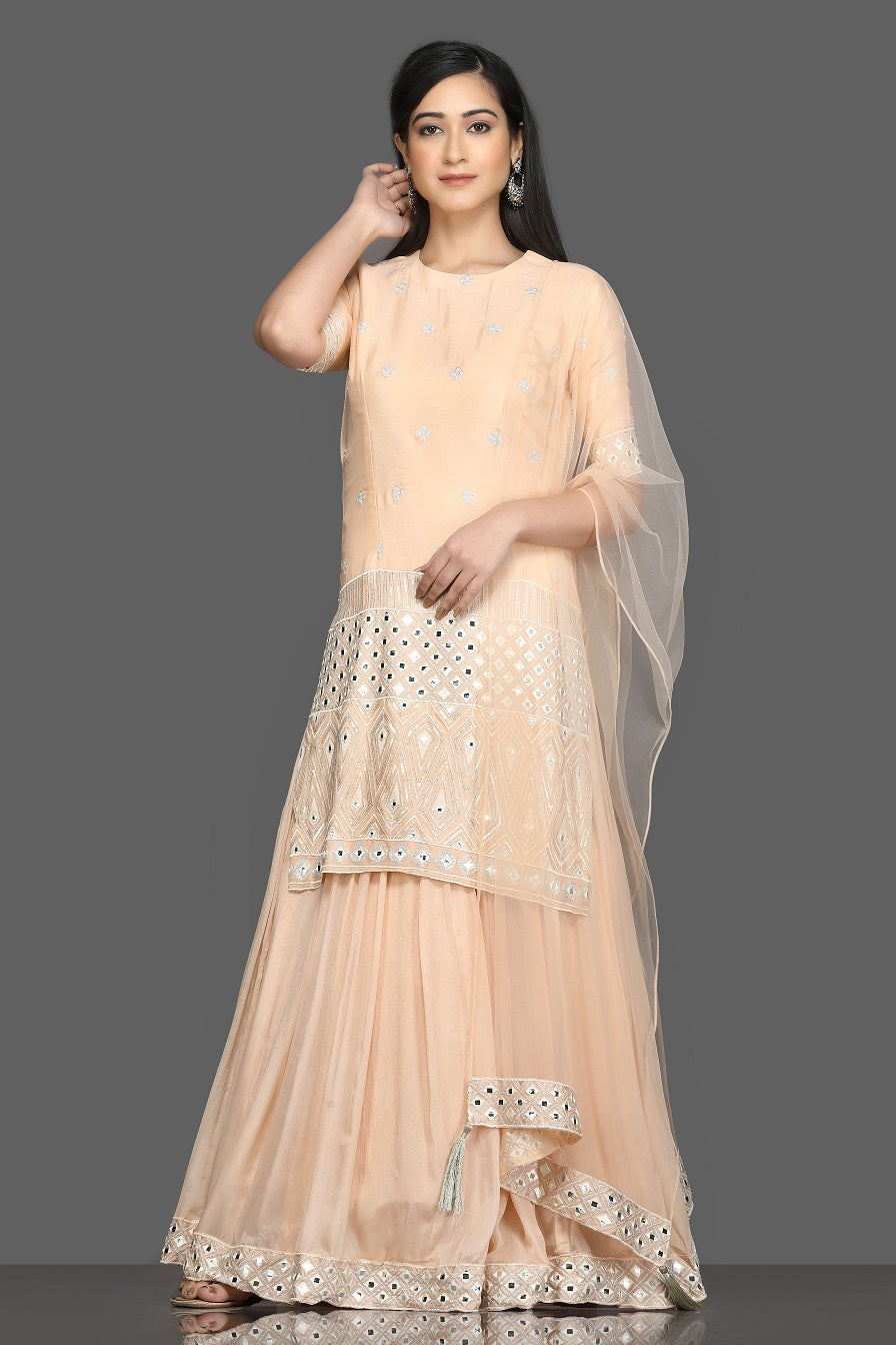 Shop elegant peach embroidered lehenga online in USA with dupatta. Dazzle on weddings and special occasions with exquisite Indian designer dresses, sharara suits, Anarkali suits, bridal lehengas from Pure Elegance Indian fashion store in USA.-full view