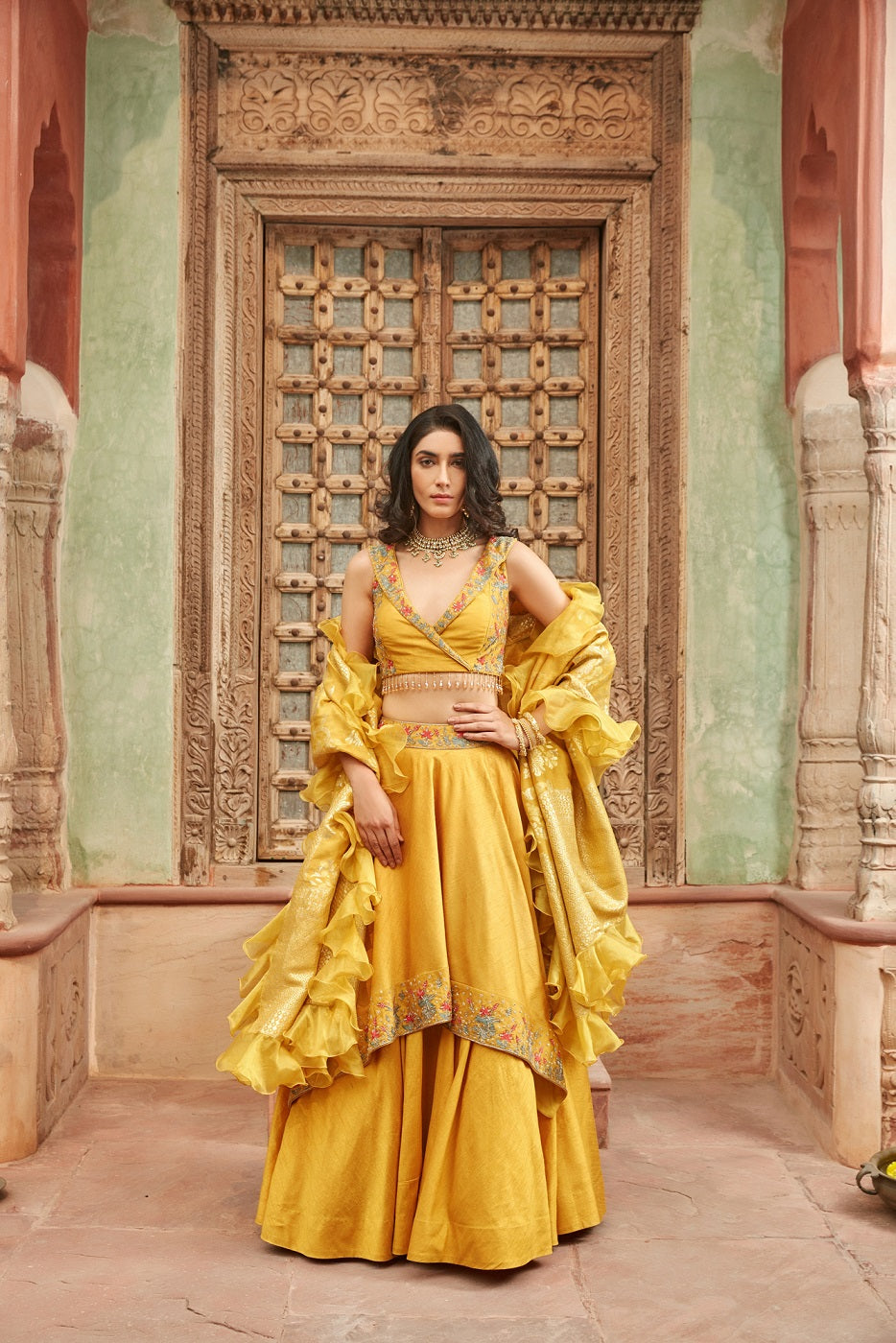 Shop gorgeous yellow embroidered raw silk lehenga online in USA with dupatta. Elevate your ethnic style with a tasteful collection of designer Anarkali, designer salwar suits, designer lehengas, sharara suits from Pure Elegance Indian clothing store in USA.-full view