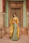 Shop beautiful yellow and green embroidered Banarasi lehenga online in USA with dupatta. Elevate your ethnic style with a tasteful collection of designer Anarkali, designer salwar suits, designer lehengas, sharara suits from Pure Elegance Indian clothing store in USA.-full view