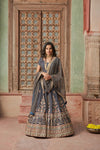 Buy stunning charcoal grey embroidered net lehenga online in USA with dupatta. Elevate your ethnic style with a tasteful collection of designer Anarkali, designer salwar suits, designer lehengas, sharara suits from Pure Elegance Indian clothing store in USA.-full view