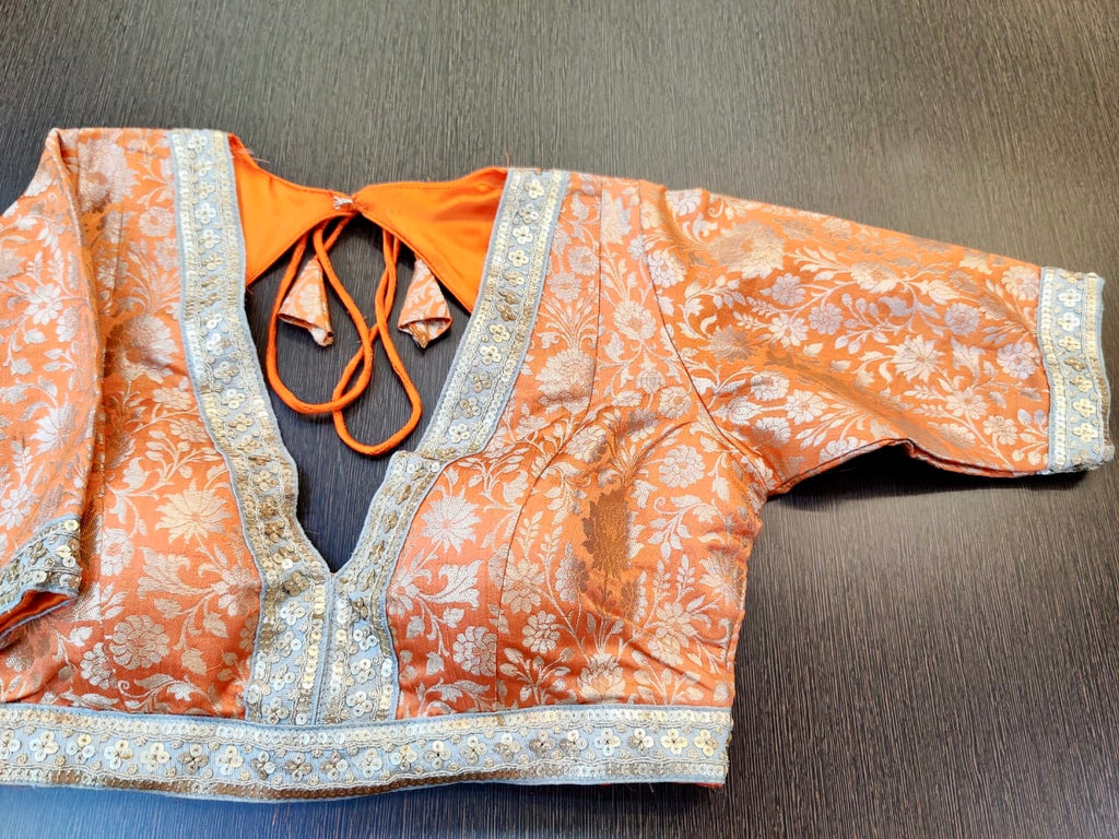 Buy stunning orange designer saree blouse online in USA with embroidered lace. Elevate your ethnic saree style with a tasteful collection of designer saree blouses, embroidered saree blouses, Banarasi saree blouse, silk sari blouse from Pure Elegance Indian clothing store in USA.-full view