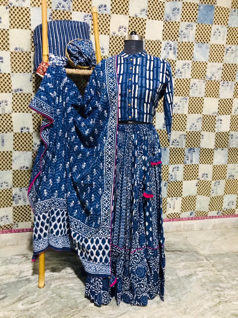 Buy stunning blue Bagru print cotton skirt set online in USA. Elevate your ethnic style with a tasteful collection of designer Anarkali suits, designer salwar suits, Indian lehengas, sharara suits from Pure Elegance Indian clothing store in USA.-front