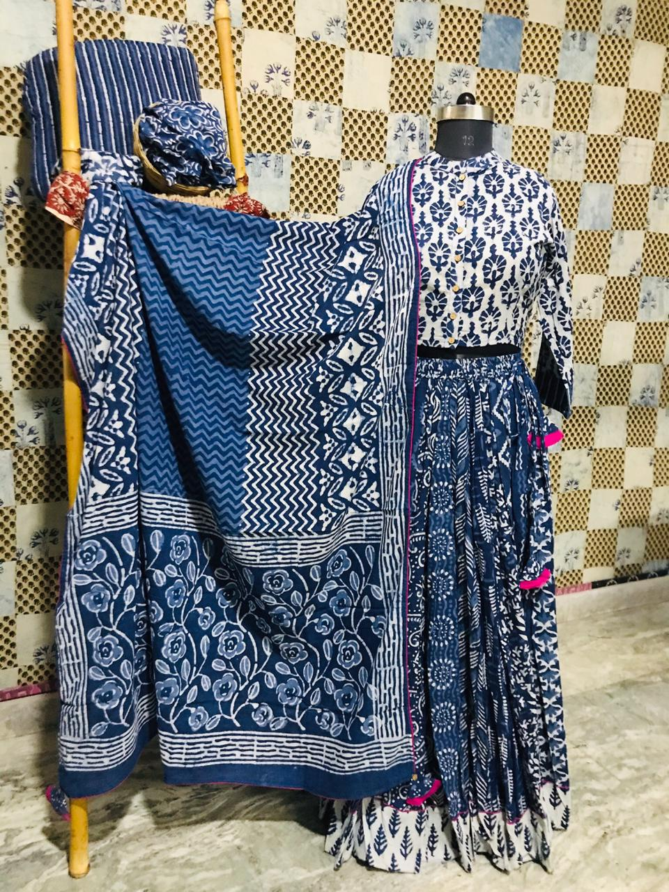 Shop stunning white and blue Bagru cotton skirt set online in USA with dupatta. Elevate your ethnic style with a tasteful collection of designer Anarkali suits, designer salwar suits, Indian lehengas, sharara suits from Pure Elegance Indian clothing store in USA.-full view