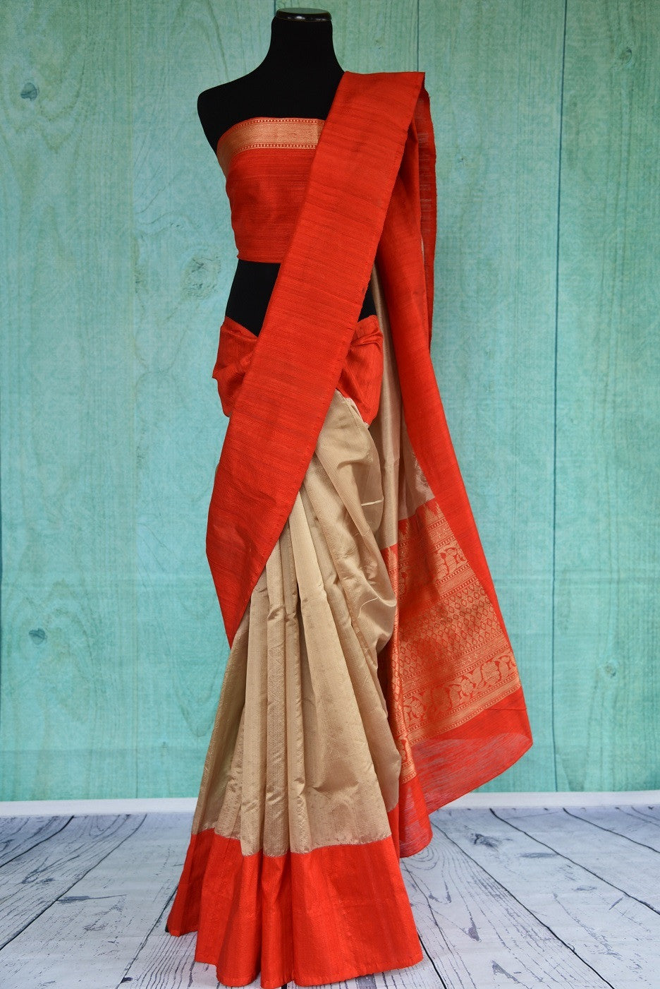 90B657 Soft gold & a bright red Banarasi silk saree with gicha border available at our ethnic wear store. The simple saree, available online at Pure Elegance, is perfect Indian wear for wedding functions and ethnic occasions.
