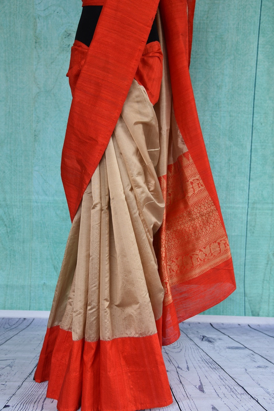 90B657 Soft golden &  bright red Banarasi silk saree with gicha border available at our Indian wear store in USA. The striking, yet simple saree is available online at Pure Elegance and is ideal ethnic wear for wedding functions and ethnic occasions.