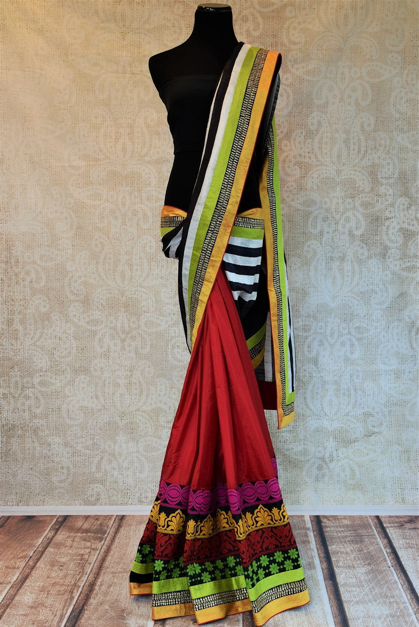 90a728 This half matka, half silk saree from India can be bought at our Indian clothing store online in USA. The red saree with multi-colored border is a wonderfully versatile ethnic outfit that you can wear for weddings and parties.