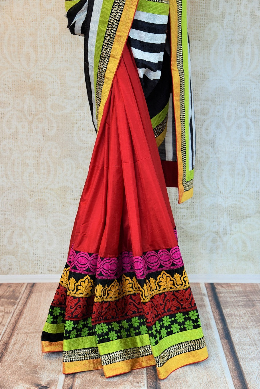 90a728 This half matka, half silk embroidered saree online in USA can be bought at our Indian clothing - Pure Elegance. The red saree with multi-colored border is a wonderfully versatile ethnic outfit that you can wear for parties and wedding functions.