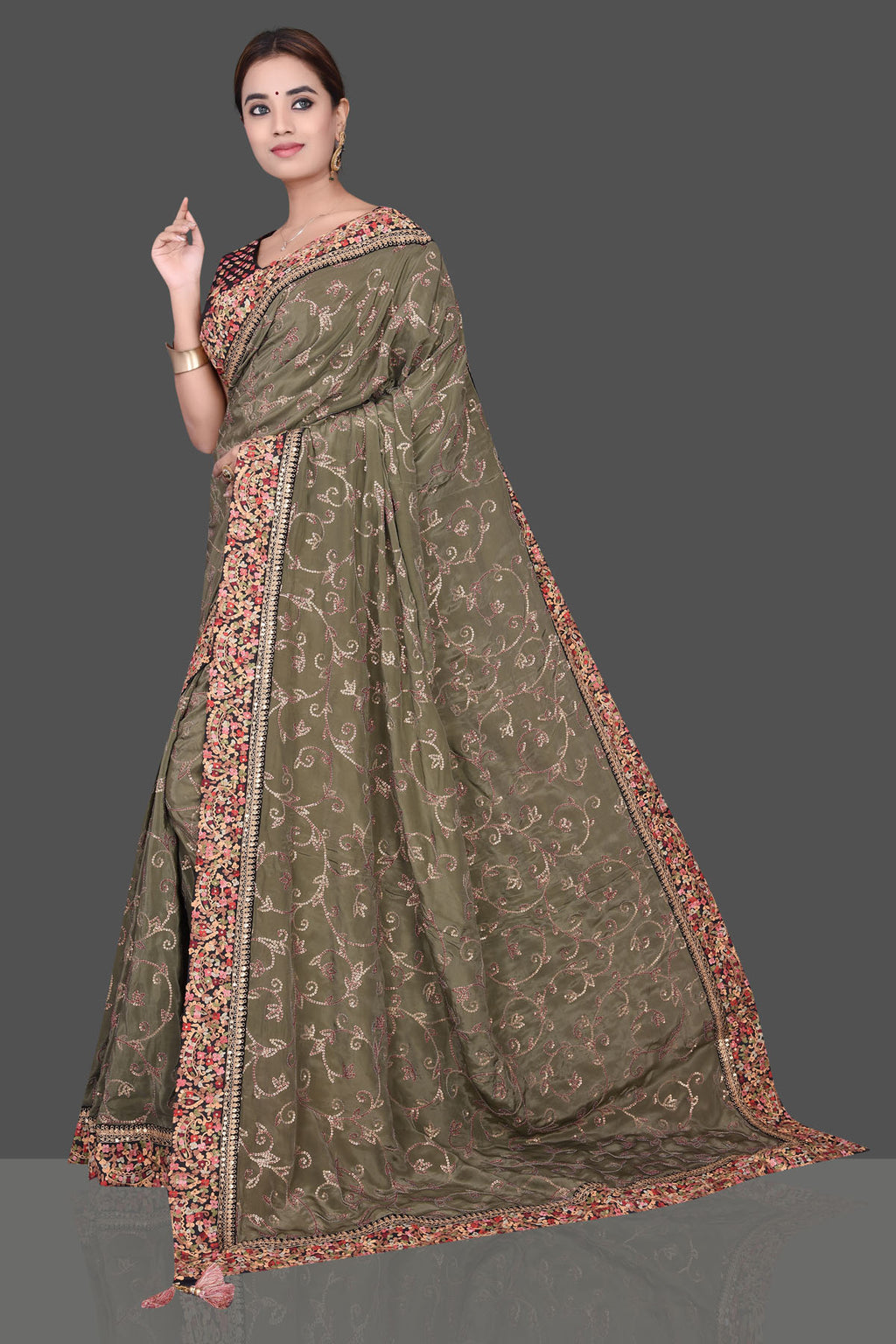 Shop beautiful olive green embroidered crepe silk saree online in USA with black embroidered saree blouse. Shop beautiful embroidered sarees, Banarasi saris, georgette sarees, designer sarees in USA from Pure Elegance Indian fashion store in USA. Shop online now.-full view