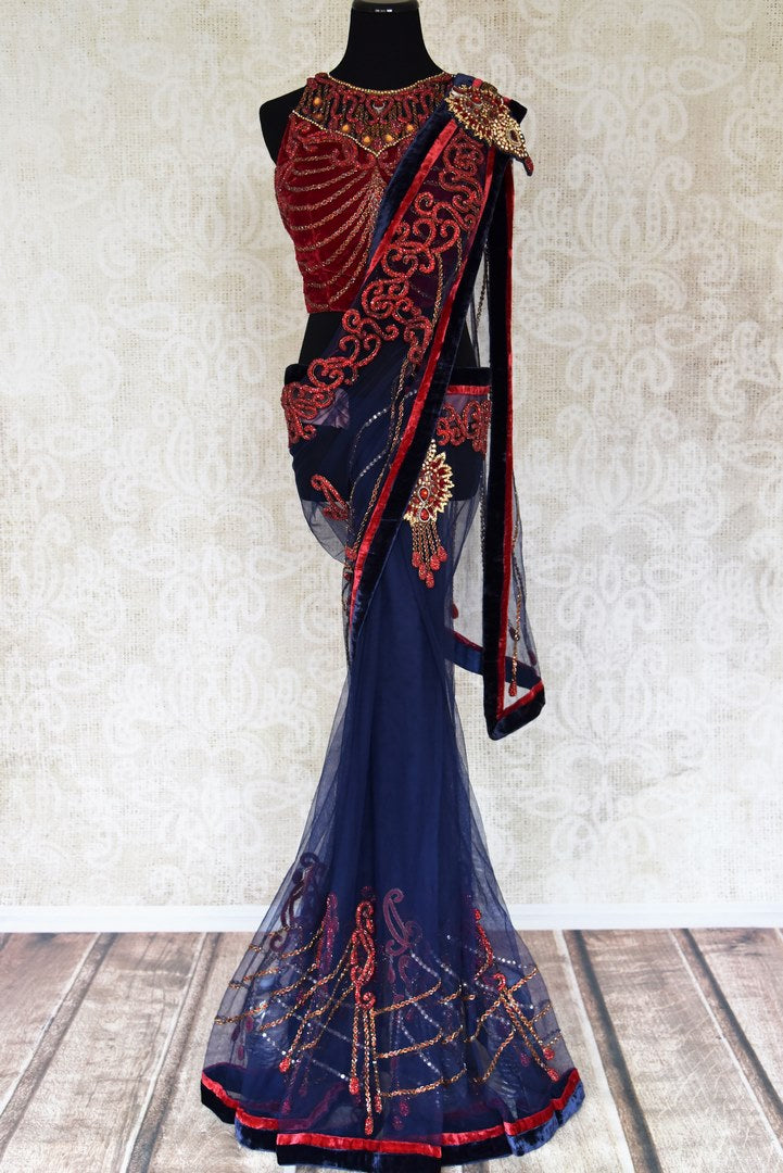 Buy navy blue embroidered fancy net saree with red blouse online in USA from Pure Elegance. Choose from a range of exclusive Indian designer sarees, wedding saris, embroidered sarees in beautiful styles and designs from our Indian fashion store in USA and flaunt your tasteful sartorial choices on special occasions.-full view