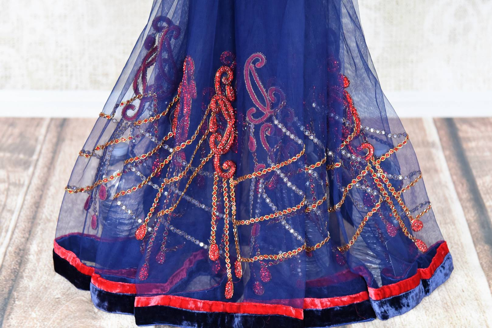 Buy navy blue embroidered fancy net saree with red blouse online in USA from Pure Elegance. Choose from a range of exclusive Indian designer sarees, wedding saris, embroidered sarees in beautiful styles and designs from our Indian fashion store in USA and flaunt your tasteful sartorial choices on special occasions.-pleats