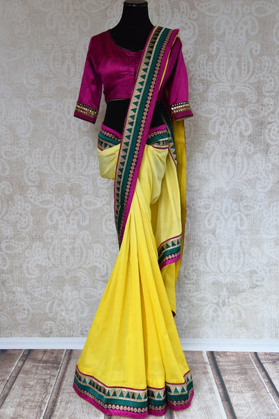 90A484 Lemon yellow saree with maroon blouse that makes for the perfect Indian outfit for wedding function and festivities. Buy this traditional Georgette tussar saree at Pure Elegance.