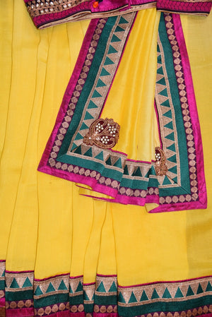 90A484 Lemon yellow saree with maroon blouse that makes for the perfect Indian outfit for wedding function and festivities. Buy this traditional Georgette tussar saree at our Indian wear store in USA - Pure Elegance.