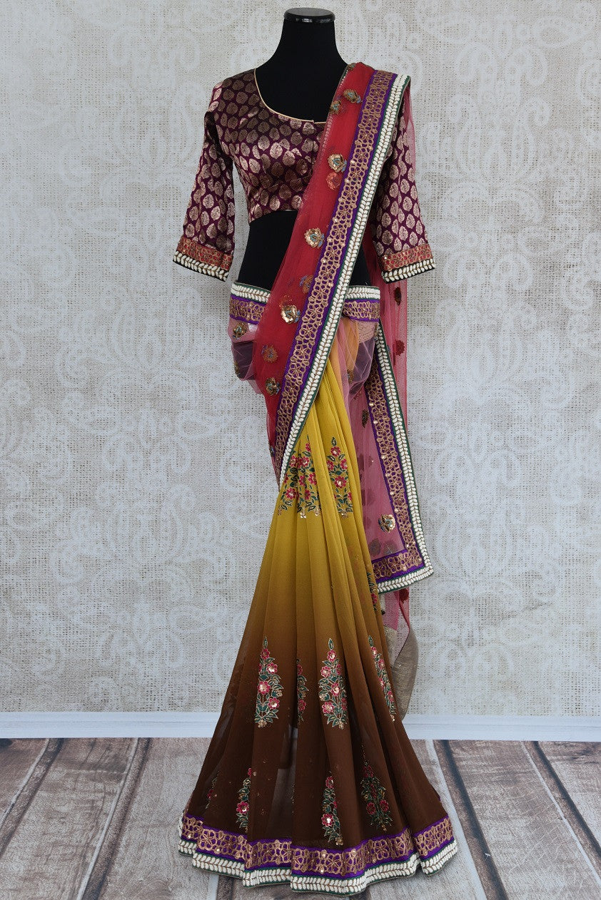 90A486 Traditional Indian half georgette, half net sari with traditional motifs and embellishments with designer blouse. This saree is ideal for Indian weddings. The shaded yellow and pink saree is available online at our ethnic clothing store in USA - Pure Elegance.