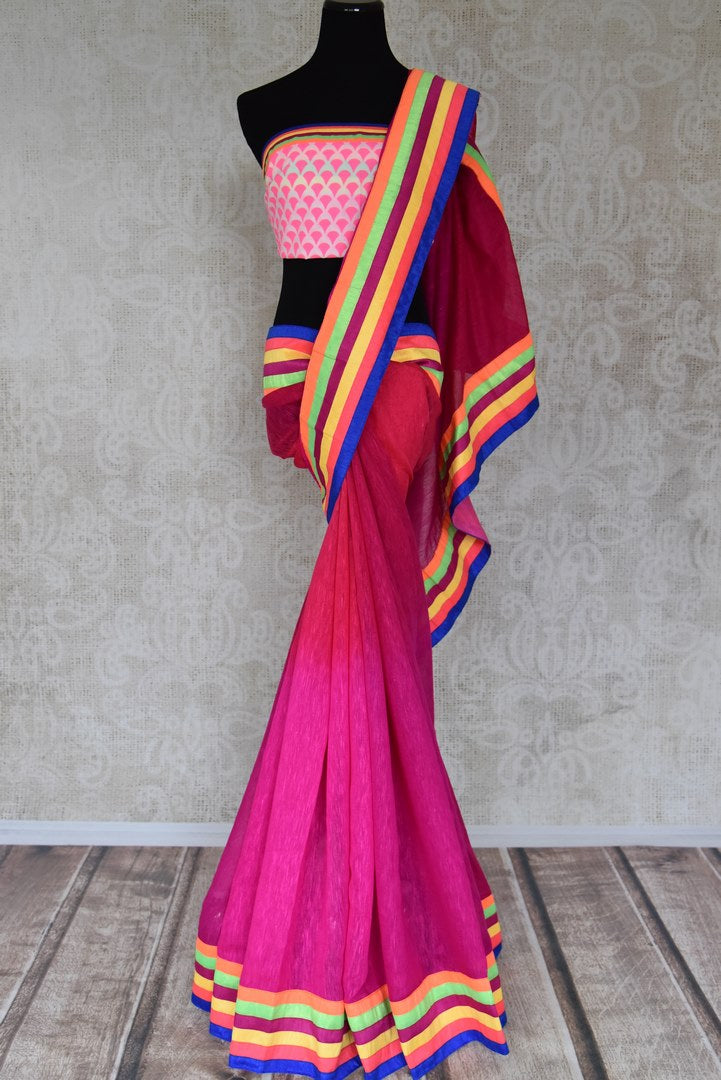 Shop bright pink linen saree online in USA with colorful striped border from Pure Elegance. Let your ethnic style be one of a kind with an exquisite variety of Indian handloom sarees, pure silk sarees, designer sarees from our exclusive fashion store in USA.-full view
