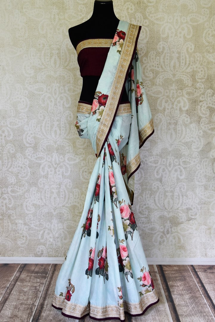Shop beautiful powder blue floral Muga saree online in USA with embroidered border. Shop the latest Indian women clothing and designer sarees for weddings and special occasions from Pure Elegance Indian clothing store in USA.-full view