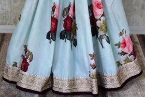 Shop beautiful powder blue floral Muga saree online in USA with embroidered border. Shop the latest Indian women clothing and designer sarees for weddings and special occasions from Pure Elegance Indian clothing store in USA.-pleats