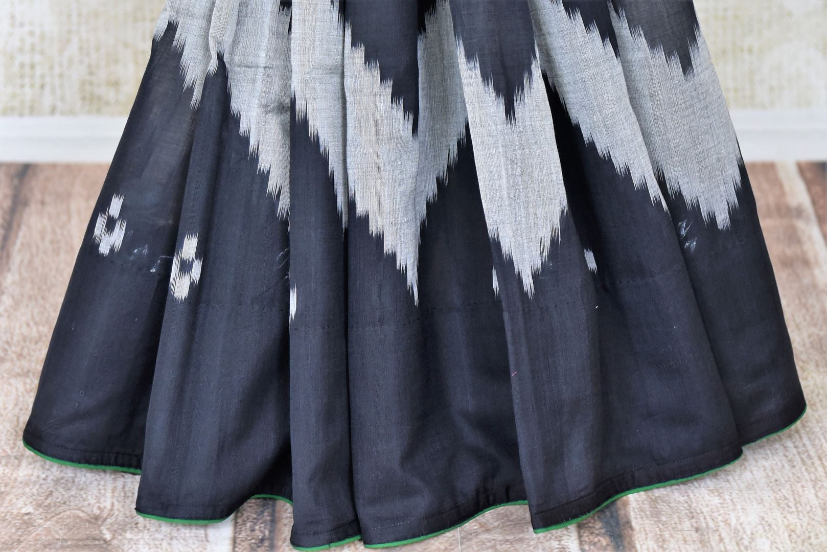 Buy gorgeous black and white ikkat cotton saree online in USA. Shop beautiful handwoven sarees for weddings and special occasions from Pure Elegance Indian clothing store in USA.-pleats