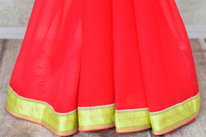 Buy red chiffon saree online in USA with neon green saree blouse. Shop the latest designer saris for weddings and special occasions from Pure Elegance Indian clothing store in USA.-pleats