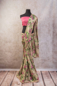 90a681 This satin crepe floral saree available online at our Indian clothing store online in USA is a stunner. This beige saree with purple and green rose print is an ideal party saree to have in your ethnic clothing collection.
