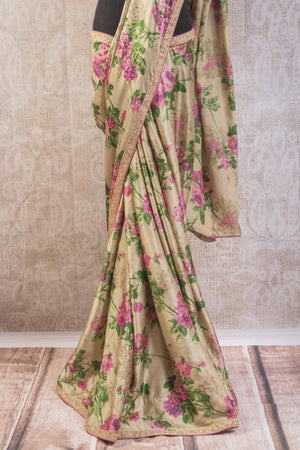 90a681 This beige rose floral saree available online at our Indian clothing store online in USA is a stunner. This satin crepe printed saree is an ideal party saree to have in your ethnic clothing collection.