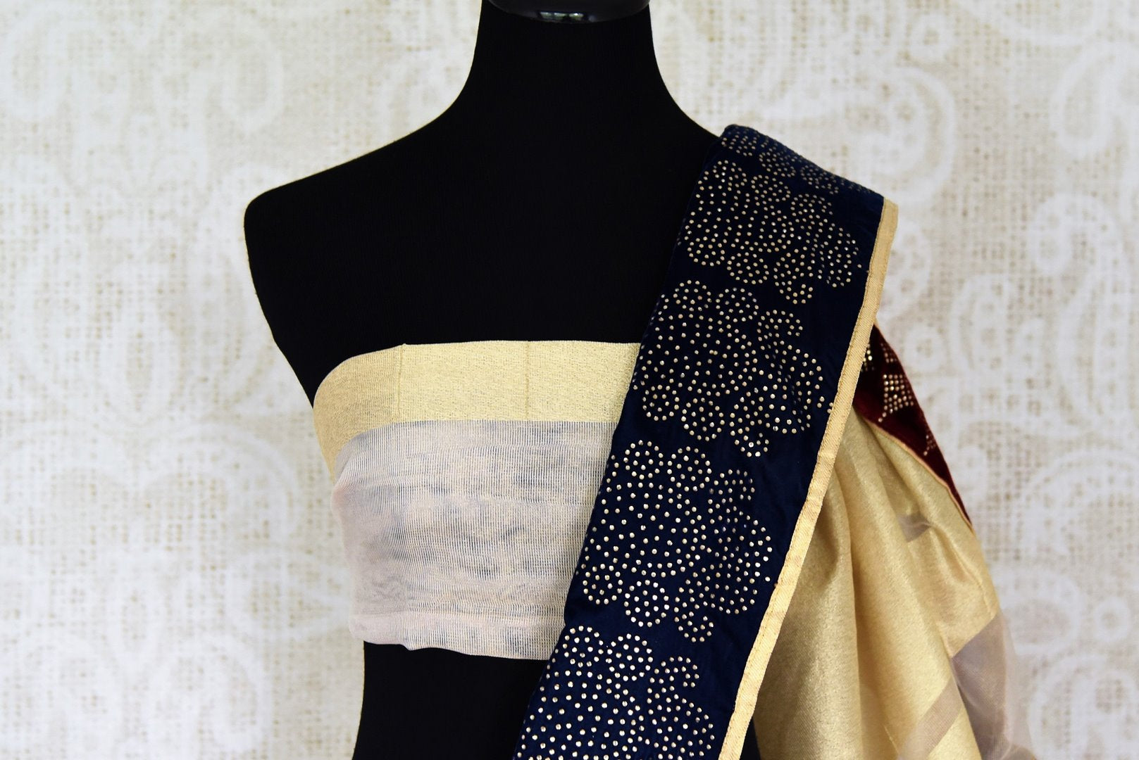Shop cream net saree online in USA with blue stone work border. Shop the latest Indian women clothing and designer sarees for weddings and special occasions from Pure Elegance Indian clothing store in USA.-blouse pallu