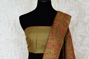 Buy olive green embroidered tussar silk saree online in USA. Shop beautiful designer sarees for weddings and special occasions from Pure Elegance Indian clothing store in USA.-blouse pallu