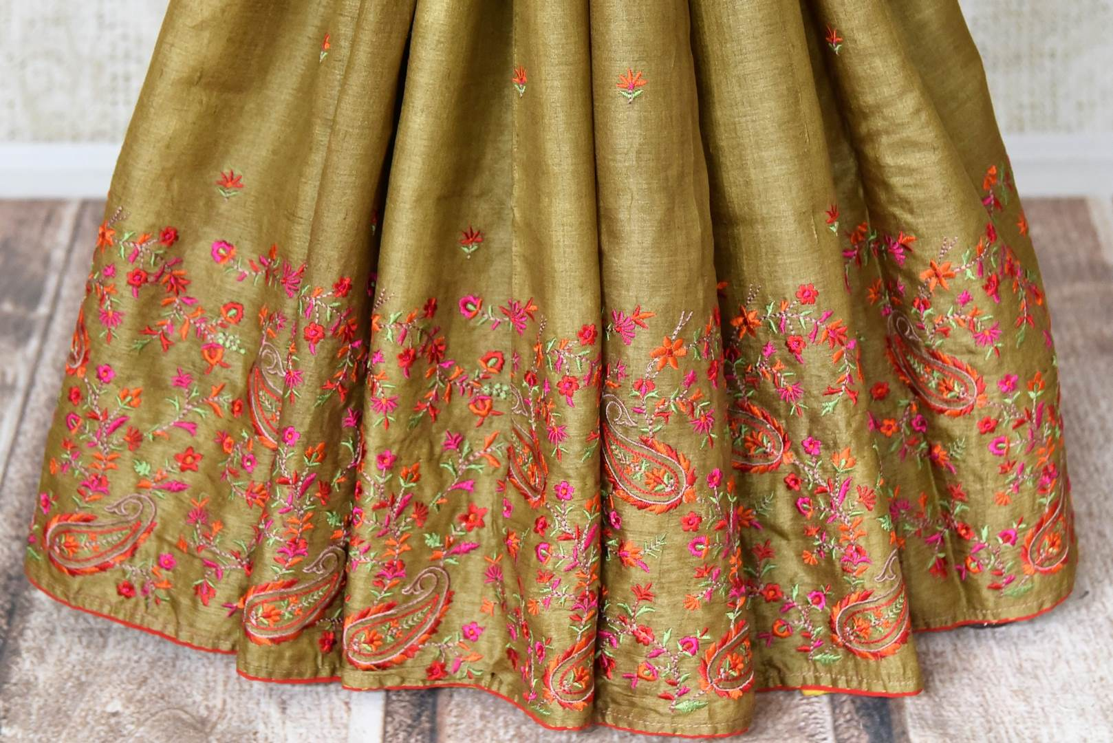 Buy olive green embroidered tussar silk saree online in USA. Shop beautiful designer sarees for weddings and special occasions from Pure Elegance Indian clothing store in USA.-pleats