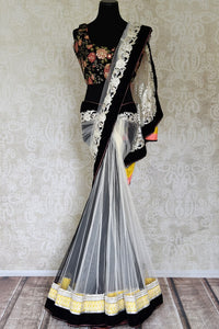 Buy white and black embroidered net saree online in USA with embroidered saree blouse. Shop beautiful designer sarees for weddings and special occasions from Pure Elegance Indian clothing store in USA.-full view