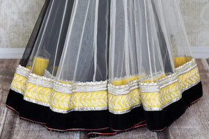 Buy white and black embroidered net saree online in USA with embroidered saree blouse. Shop beautiful designer sarees for weddings and special occasions from Pure Elegance Indian clothing store in USA.-pleats