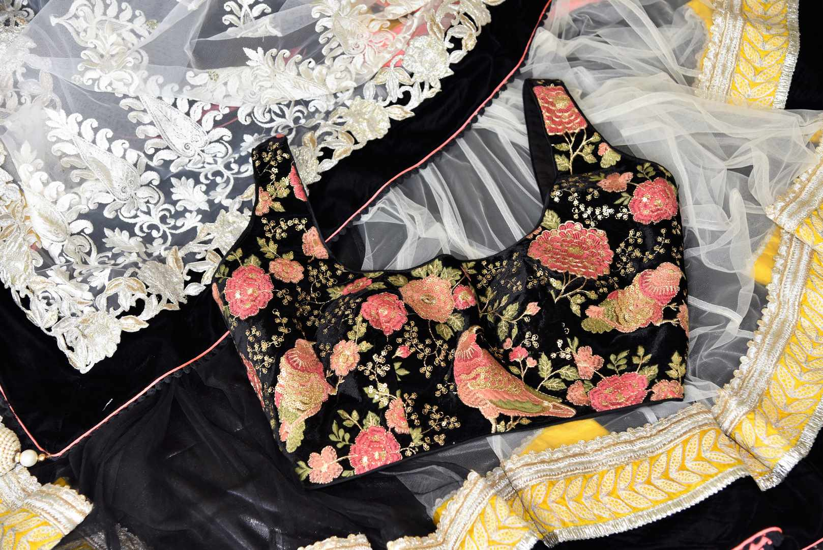Buy white and black embroidered net saree online in USA with embroidered saree blouse. Shop beautiful designer sarees for weddings and special occasions from Pure Elegance Indian clothing store in USA.-details