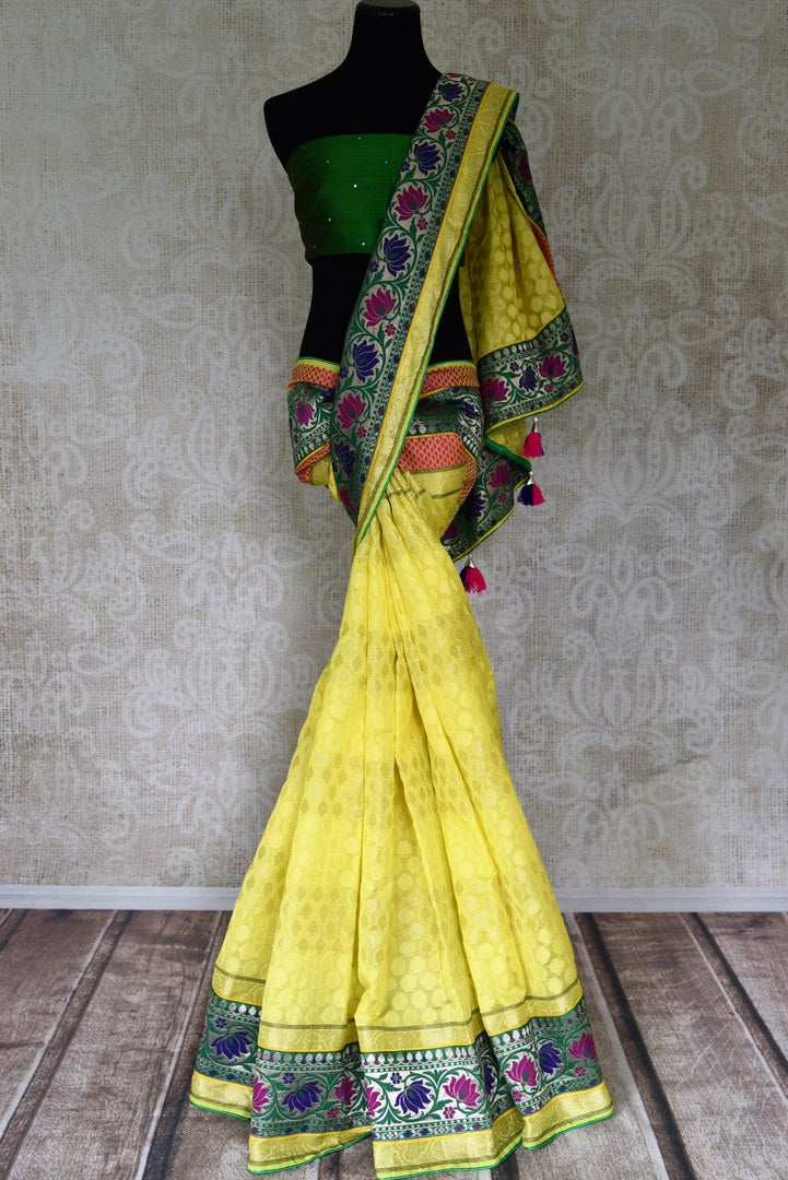 Buy bright yellow silk saree online in USA with floral zari minakari border. Shop the latest Indian women clothing and designer sarees for weddings and special occasions from Pure Elegance Indian clothing store in USA.-full view