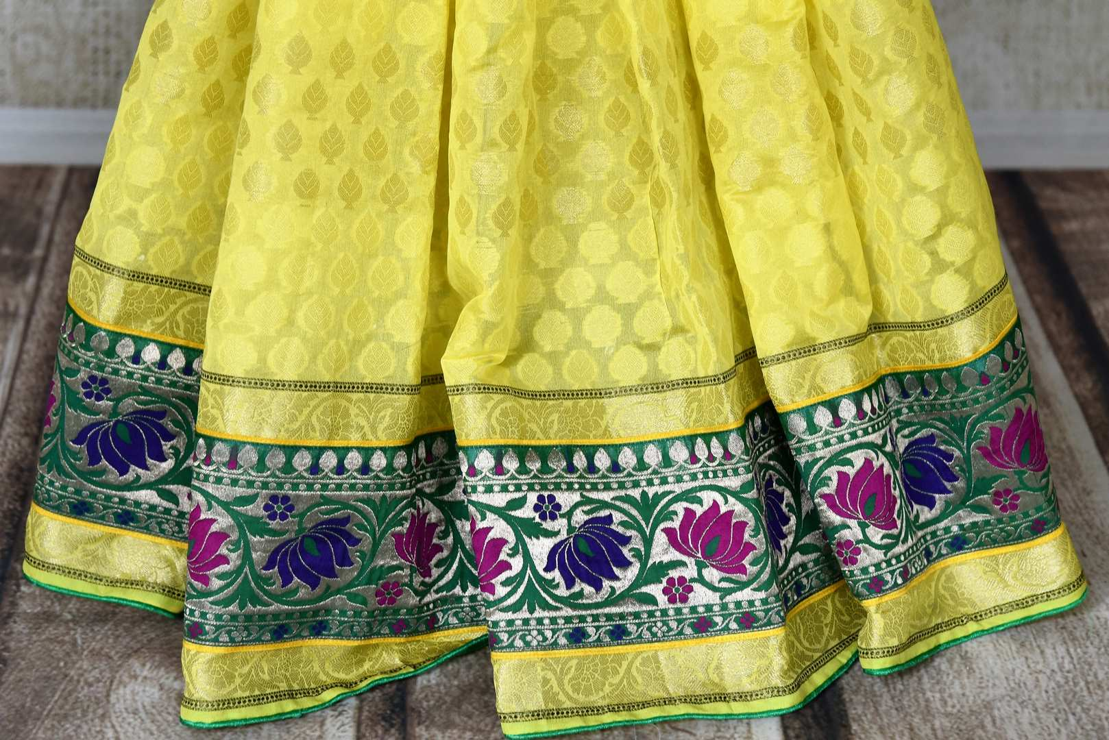 Buy bright yellow silk saree online in USA with floral zari minakari border. Shop the latest Indian women clothing and designer sarees for weddings and special occasions from Pure Elegance Indian clothing store in USA.-pleats