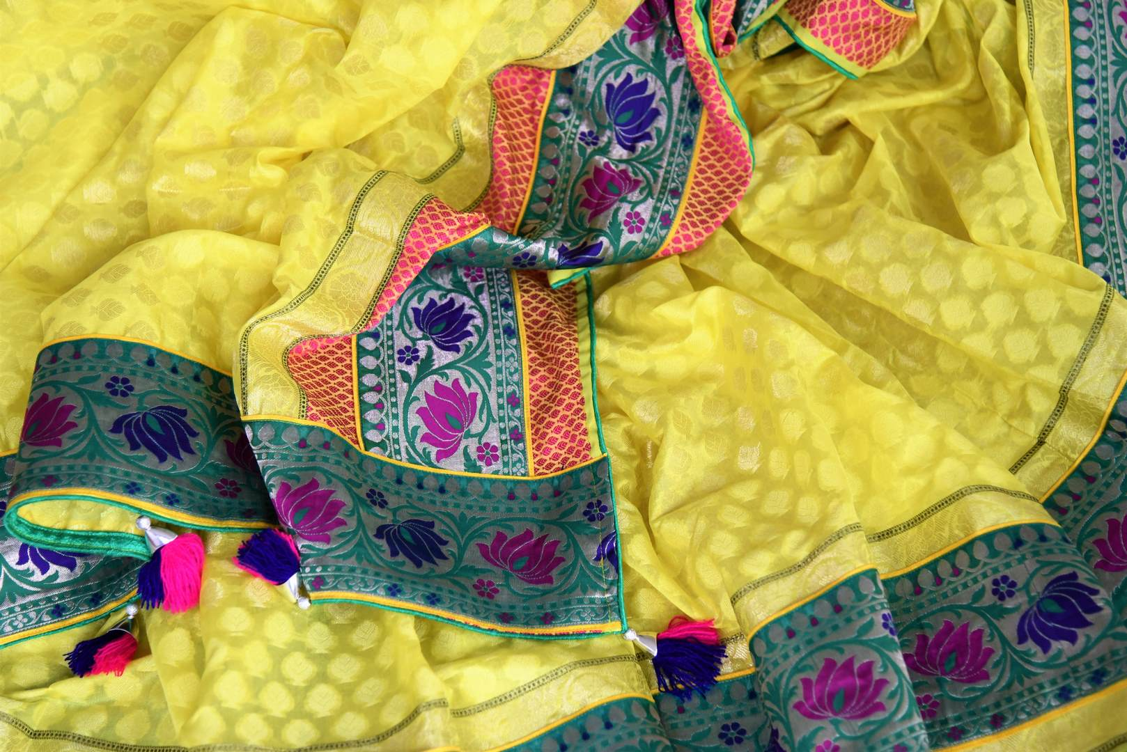 Buy bright yellow silk saree online in USA with floral zari minakari border. Shop the latest Indian women clothing and designer sarees for weddings and special occasions from Pure Elegance Indian clothing store in USA.-details