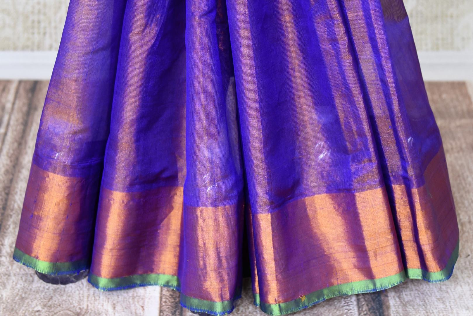Shop blue Uppada silk saree online in USA with gold zari border. Shop the latest Indian women clothing and designer sarees for weddings and special occasions from Pure Elegance Indian clothing store in USA.-pleats