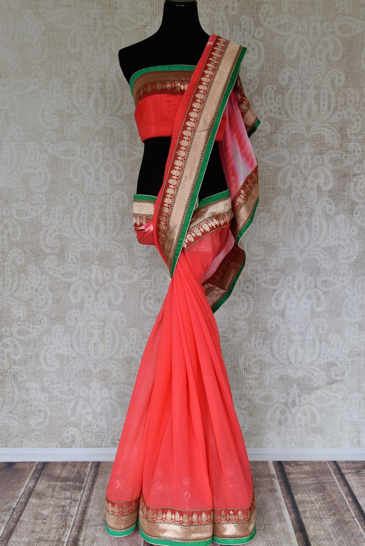 Shop orange crushed tie and dye chiffon sari online in USA with zari patti. Elevate your traditional style with exquisite Indian designer sarees from Pure Elegance Indian clothing store in USA. Explore a range of stunning silk sarees, embroidered sarees, wedding sarees especially from India for women in USA.-full view