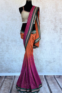 90a732 Buy this orange & pink embroidered saree with green border at our Indian clothing store online in USA. This georgette sari is supremely versatile and a fantastic choice for parties & weddings.