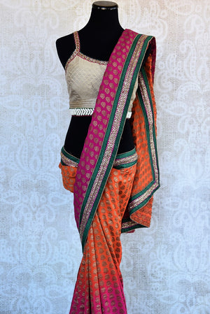 90A769 Buy this orange & pink embroidered saree with green border at our Indian clothing store online in USA. The khadi georgette sari makes for a wonderful wedding and party wear saree.