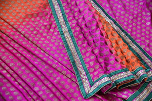 90A769 Buy this orange & pink embroidered saree with green border at our Indian clothing store online in USA. The khadi georgette sari makes for a wonderful party and wedding outfit and is a classic you just can't go wrong with.