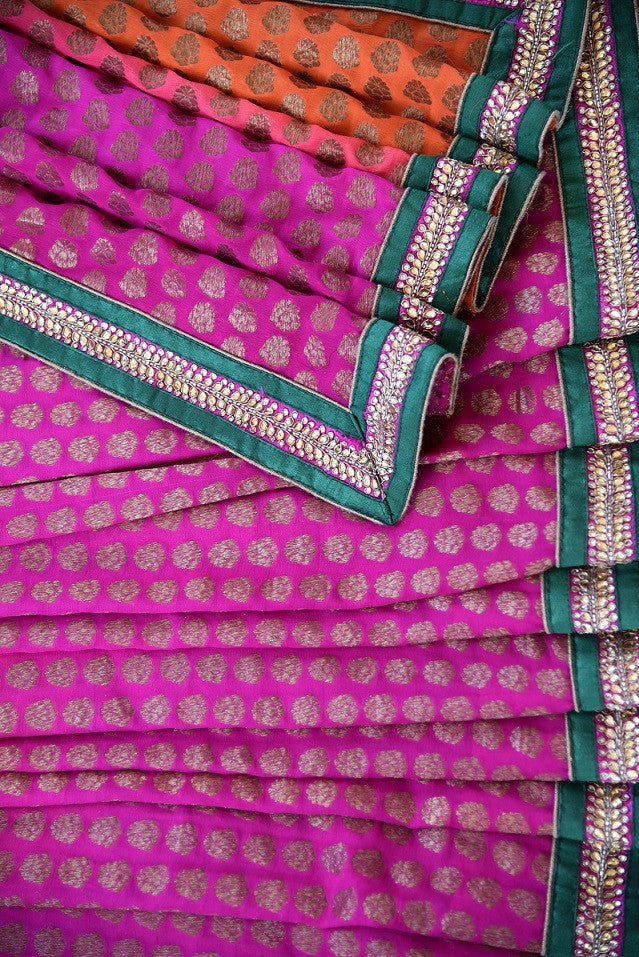 90A769 Buy this shaded orange & pink embroidered saree with green border trim at our Indian fashion store online in USA. The khadi georgette sari will be a lovely addition to your ethnic clothing closet.