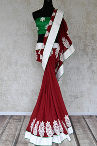 Buy maroon linen raw silk applique saree online in USA with white border from Pure Elegance. Let your ethnic style be one of a kind with an exquisite variety of Indian handloom sarees, pure silk sarees, designer sarees from our exclusive fashion store in USA.-full view
