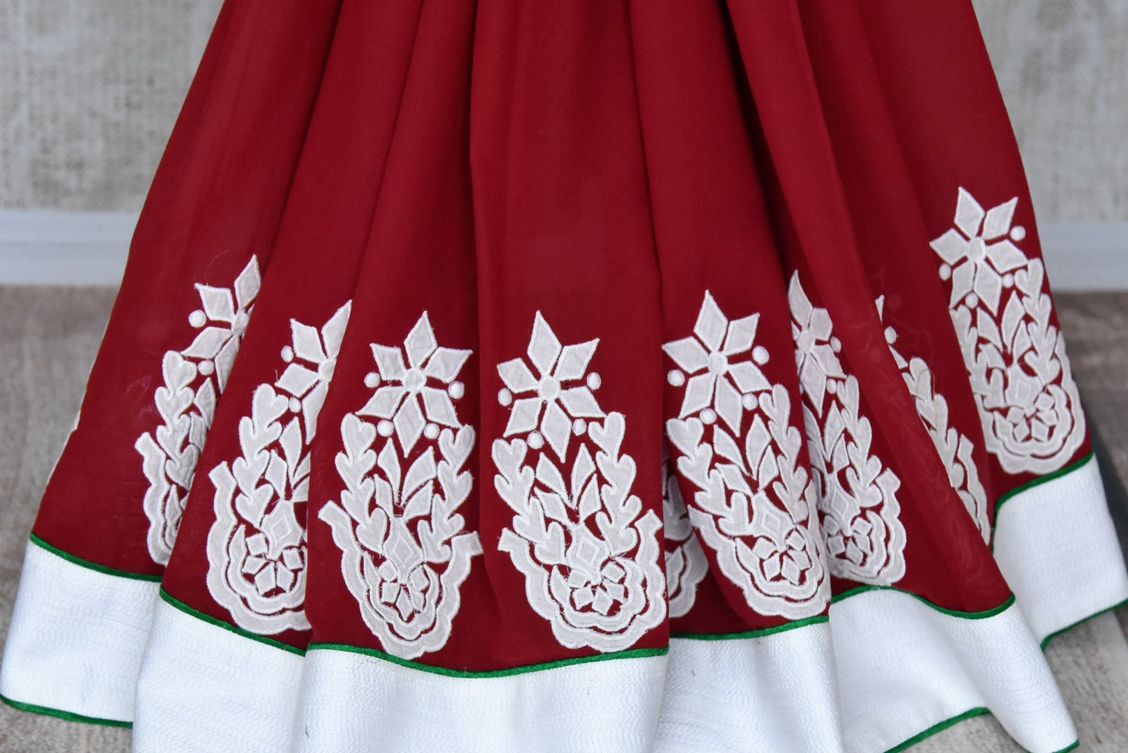 Buy maroon linen raw silk applique saree online in USA with white border from Pure Elegance. Let your ethnic style be one of a kind with an exquisite variety of Indian handloom sarees, pure silk sarees, designer sarees from our exclusive fashion store in USA.-pleats