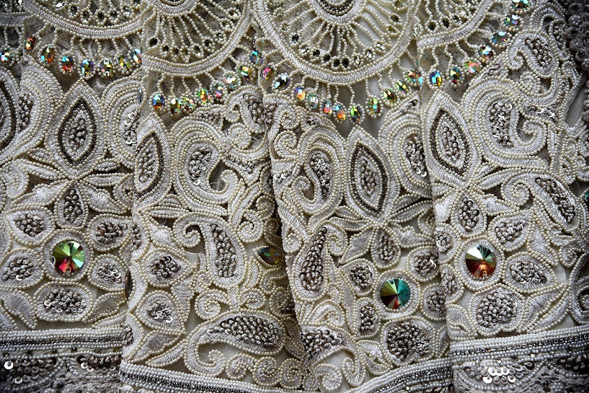 90A939 White net and lace saree with intricate hand moti work. The exquisite party wear saree can be bought online at our Indian clothing store online in USA - Pure Elegance. The beautiful ethnic sari will be a fantastic addition to your Indian wear wardrobe.