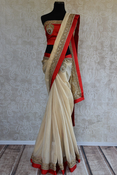 90A948 Buy this traditional white and red saree online in USA at our Indian clothing store. The embroidered tissue saree makes for the perfect ethnic outfit for Indian weddings!