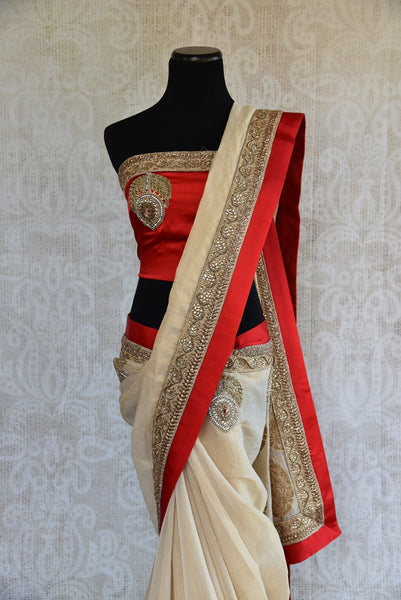 90A948 Buy this classic white and red saree online at our Indian clothing store in USA. The embroidered tissue saree makes for the ideal ethnic outfit for Indian wedding functions!