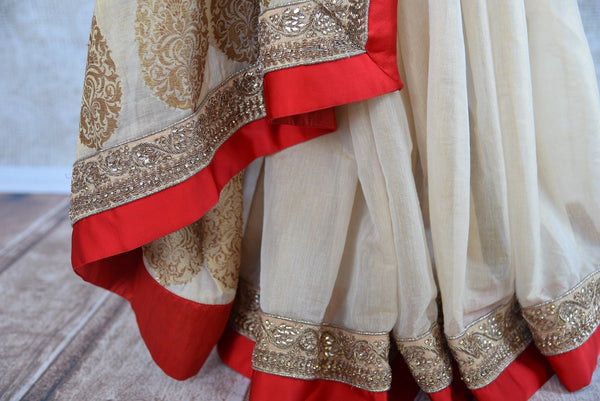 90A948 Buy this classic Indian white & red saree online at our ethnic wear store in USA. The embroidered tissue saree is a great choice Indian weddings and can be dressed up or down according to occasion.