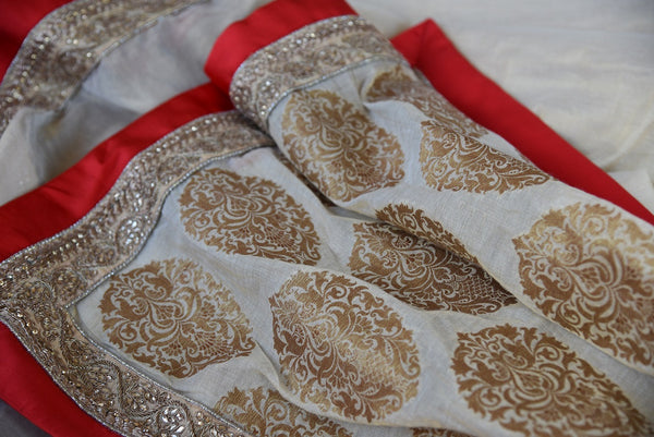 90A948 Buy this white & red saree online at our ethnic wear store online in USA. The embroidered tissue Indian saree makes for the perfect Indian wedding outfit and can be styled in very many ways!