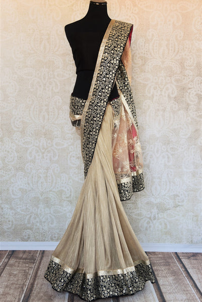 90A959 Shop this elegant matka tussar lace saree online in USA at our store ethnic wear store - Pure Elegance. This beige, black and gold saree will be a lovely addition to you party wear sarees collection and sure to have you looking breathtakingly beautiful!