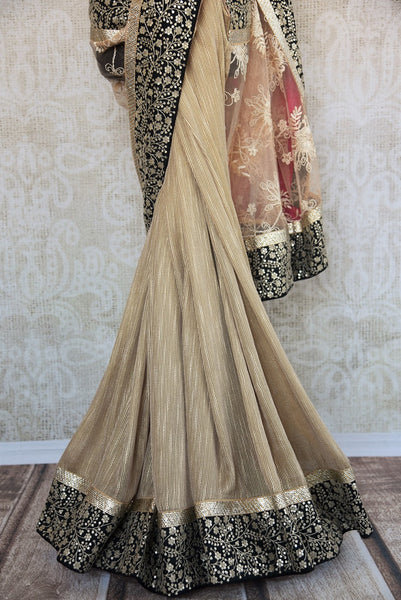 90A959 Buy this stunning matka tussar lace saree online at our Indian clothing store Pure Elegance in USA. This beige, black and gold saree from India will be a splendid addition to you party wear sarees collection.