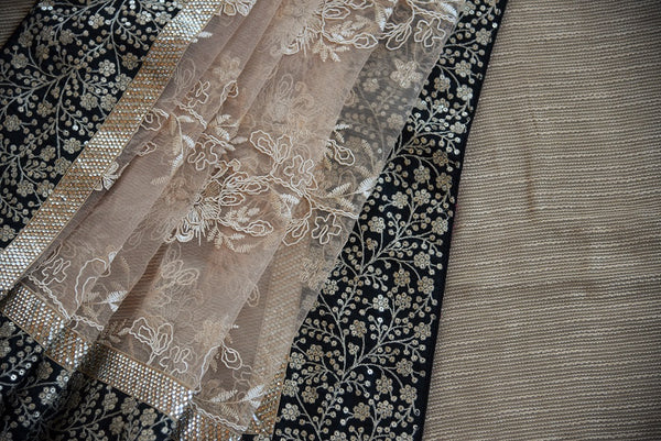 90A959 Shop this matka tussar lace saree online at our store in USA, Pure Elegance. This beige saree with embroidered black border and gold saree from india will be a stellar new addition to you party wear sarees collection.